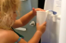 Little girl uses water cooler, doesn't quite get it right