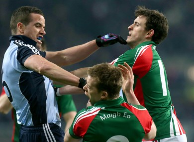 Dublin's Ger Brennan clashes with Donal Vaughan of Mayo and is sent off.