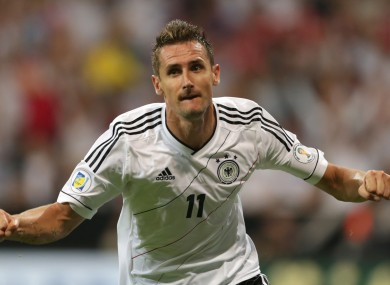 Germany's Miroslav Klose celebrates after scoring his side's opening goal tonight.