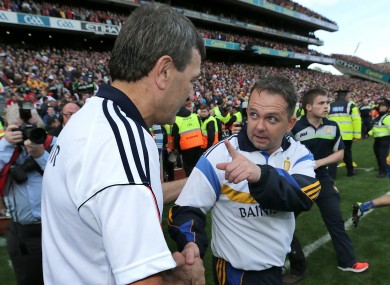 Cork manager Jimmy Barry Murphy shakes hands with Clare manager Davy Fitzgerald after today's game.