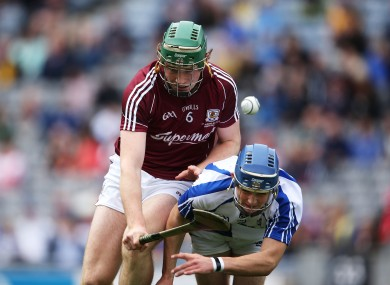 Waterford's Patrick Curran and Shane Cooney of Galway battle for possession.