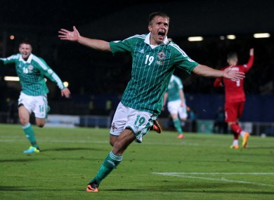 Northern Ireland's Jamie Ward celebrates putting his side into the lead against Portugal.