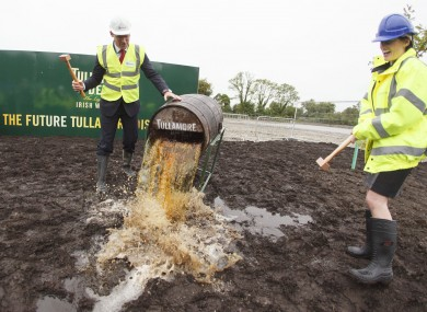 Minister for Agriculture Simon Coveney breaks a cask of Tullamore Dew with William Grant & Sons Global CEO Stella David.