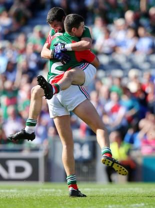 Tommy Conroy of Mayo celebrates scoring the first goal of the game with Padraig Prendergast.