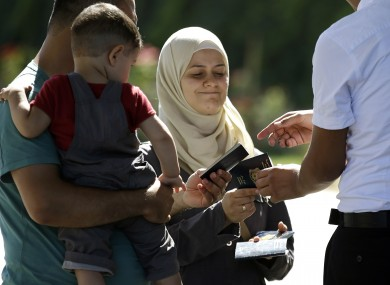 Syrian refugees have their passports checked at the Turkish Cilvegozu border gate.
