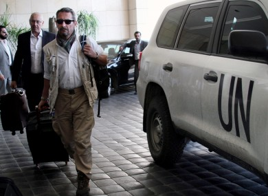 UN experts arrive at the Four Seasons hotel in Damascus last month.