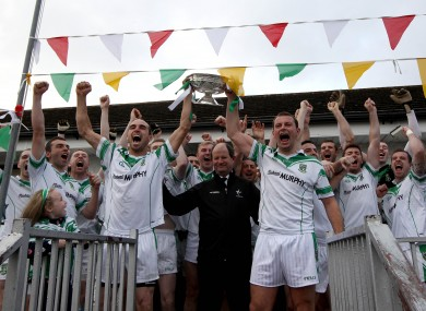 Moorefield's Kevin Murnaghan and Ross Glavin lift the trophy.