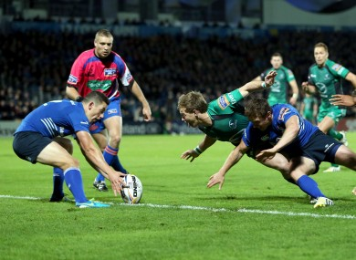 Kieran Marmion of Connacht beats Leinster's Eoin Reddan to score a try.