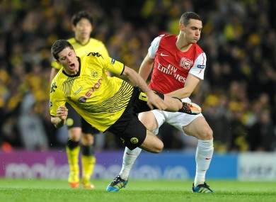 Robert Lewandowski is sent flying from a challenge by Arsenal's Thomas Vermaelen when the sides last met in 2011.