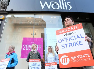 Wallis worker Melannie Rooney on strike stands outside the Wallis Shop on Grafton street