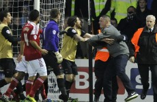 Swindon fan loses his marbles and punches Leyton Orient goalkeeper