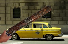Man arrested for attacking taxi with didgeridoo